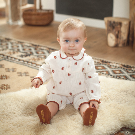 Babies overall with long legs with flowers embroidery.